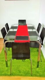 Glass dining table with six chairs in excellent condition