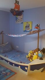 Boys next pirate ship bed and room accessories.