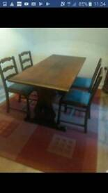 Solid Oak dining table and four chairs