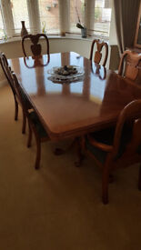 Solid wood dining room table, complete with 6 chairs (2 of which are carvers)