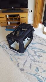Material pet carrier. New. Foldable.