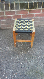 small wood framed stool with woven patterned seat