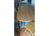 Good solid table and 6 chairs for sale