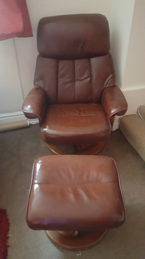 Brown leather chair and footstool