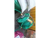 HOSE REEL FOR FITTING NEW HOSE TO OR DAMAGED HOSE COULD BE CUT TO MEND AS ITS VERY LONG