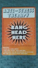 Metal wall plaque. Red/orange anti-stress therapy bang head here