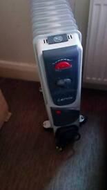 Portable oil filled radiator