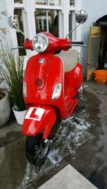 Piaggio lx 125. Good condition, lovely red!