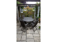 Extending teak garden table and 8 chairs.
