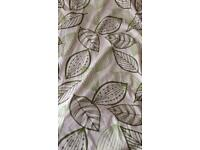 Natural lined curtains with green leaf pattern