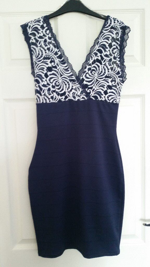 NavyWhite Lipsy dress size 10in Little Sutton, CheshireGumtree - Gorgeous Lipsy Dress Size 10 Navy with White lace size 10 Worn once and has been dry cleaned. In excellent condition cost £70 new selling for £20 Selling other other items, please have a look )