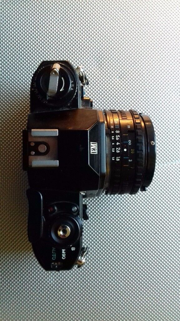 Nikon EM with 50 mm nikon lens.