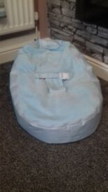 baby blue bean bag with harness and second cover