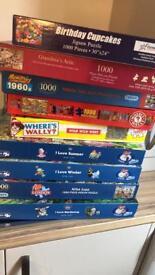Various 1000 piece puzzles