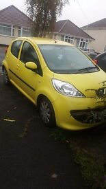 Lovely yellow Peugeot 107. £20 per year road tax, cheap insurance! MOT until june 2017.