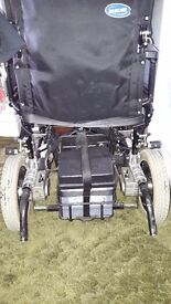 Electric wheelchair including battery charger