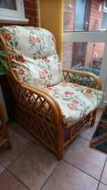 Cane conservatory side table and two chairs