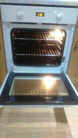 White hotpoint fan assisted oven.