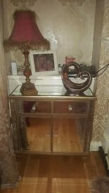 Mirrored console table with antique gold trim and matching 2 door cabinet
