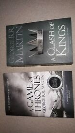 A game of thrones and A clash of kings books.