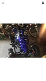 Brand new 50cc quad bike with helmet and goggles