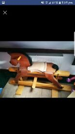 A lovely wooden rocking horse.