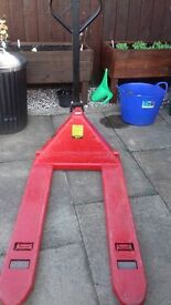 Red 2 tonne pallet truck very good condition