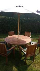 Teak 150 round table and 6 chairs