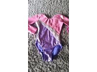 Girls gymnastics leotard (6-9) hardly worn still in excellent condition colour pink silver an purple