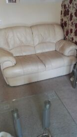 Two cream leather sofas, quite a bit of wear but otherwise ok. £25 for both, buyer must collect.