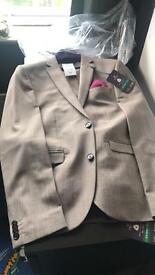 Next suit. BRAND NEW. 38R jacket 32L trousers