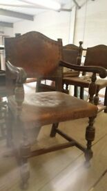 4 Oak weathered-leather castle chairs with matching carver chair