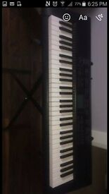 Electric Casio keyboard with stand. Full size keys. Excellent condition
