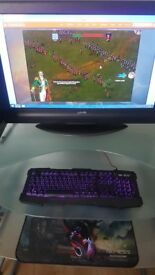 Gaming PC with 32 inch monitor, keyboard, mouse and desk
