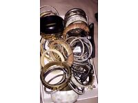 Bundle Of Women's Bangles And Rings With Some Necklaces