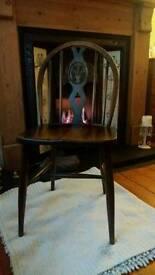 Vintage oak ercol chair .