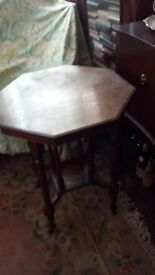 OAK TABLE . OCTAGONAL STYLE, ORIGINAL WITH CASTERS.