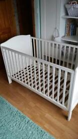 White cot and matching nappy changer