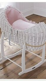 beautiful white and pink wicker pod moses basket