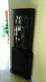 Dark wood corner unit.