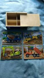 Set of jigsaw puzzles with storage box