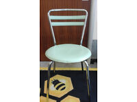 3 plastic and chrome cafe-style chairs