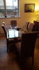 Wood and glass dinning table with 6 chairs