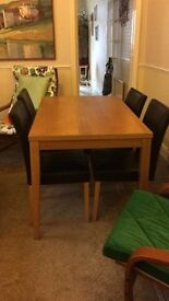 Four seat dining table for sale