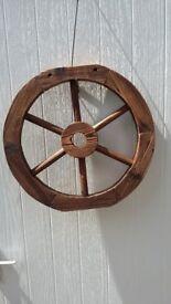 Burnt wood wagon wheel ornamental, 55cm.