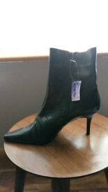Brand new Next black boots - size 6 1/2 wide fit