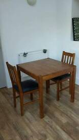 ALMOST BRAND NEW table and two chairs