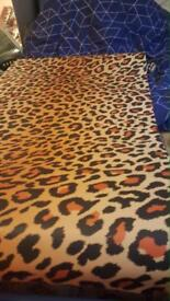 13 rolls of cheetah wallpaper £2 a roll 24£ for the lot