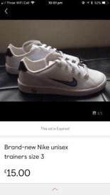 Brand-new Nike unisex trainers in size 3
