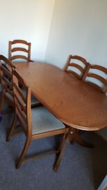 Extendable table and 6 chairs. Great condition. Always had a protecter on the table